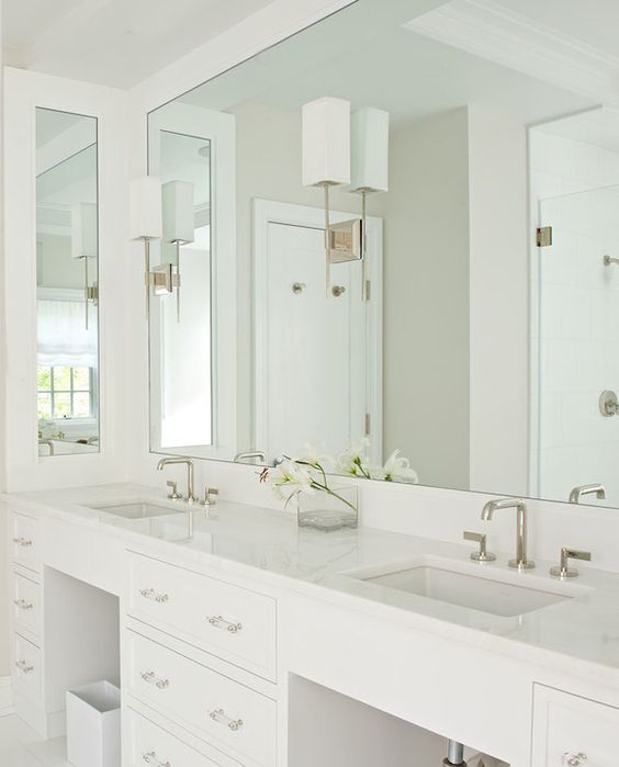 a mirror takes the whole wall with countertops and visually expands the space