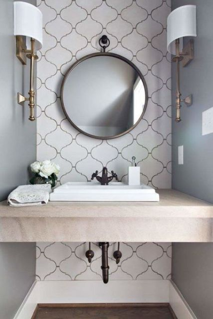 a scallped wall and a plain neutral vanity top for a cool look