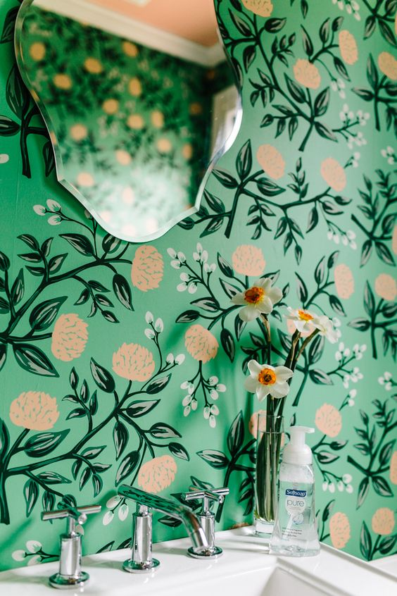 bold green wallpaper with botanical and floral prints for a girlish bathroom