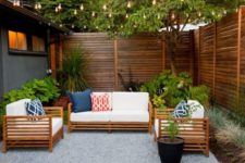 04 chic stained wooden privacy fence and furniture that echoes that shade of stain