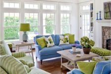 04 shades of green and blue in this living room are complemented with white and beige for a cozy feel