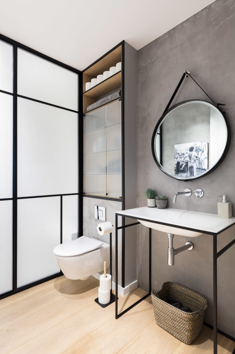 Black framing in the bathroom is a cool idea to accentuate the space