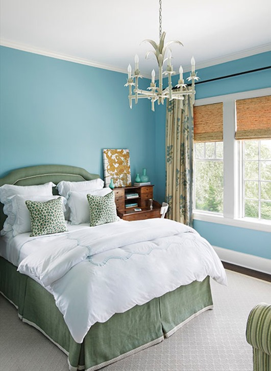 calm tone blue and green bedroom with a rustic flavor
