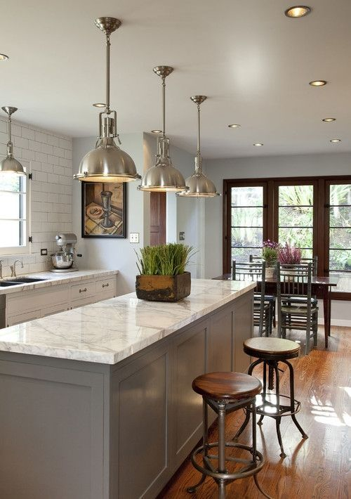 Traditional Meets Industrial Kitchen With White Quartz Counters And A Grey  Island