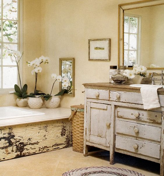 worn shabby chic bathroom vanity with a natural wood counter