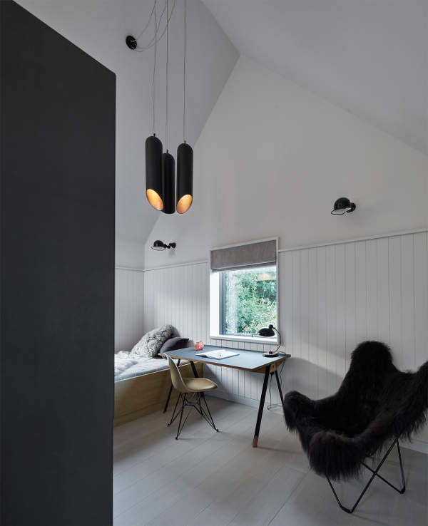 One of the bedrooms with cool pendant lamps and a desk for working