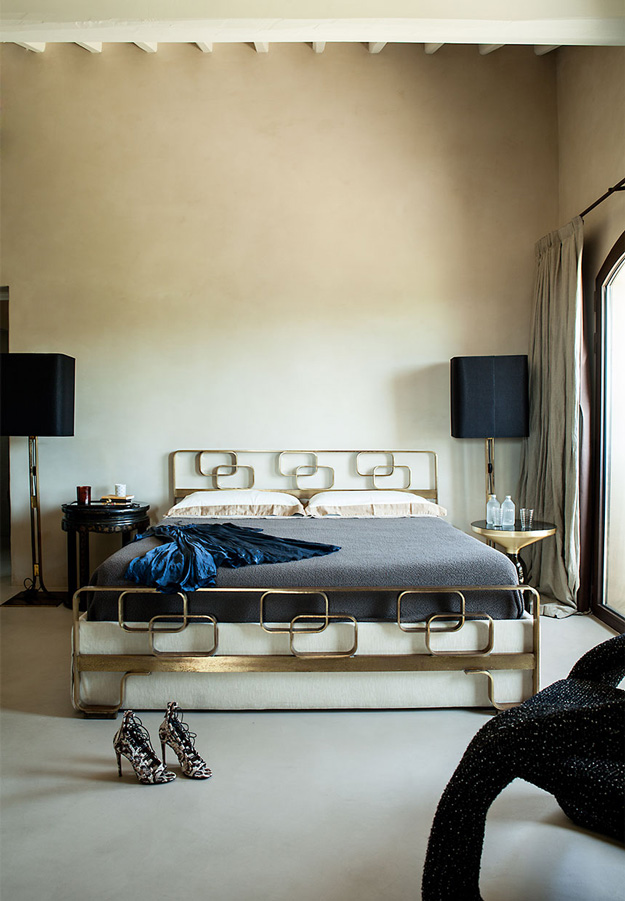 The bedroom shows a cool brass bed, lamps, nighstands and a cool chair
