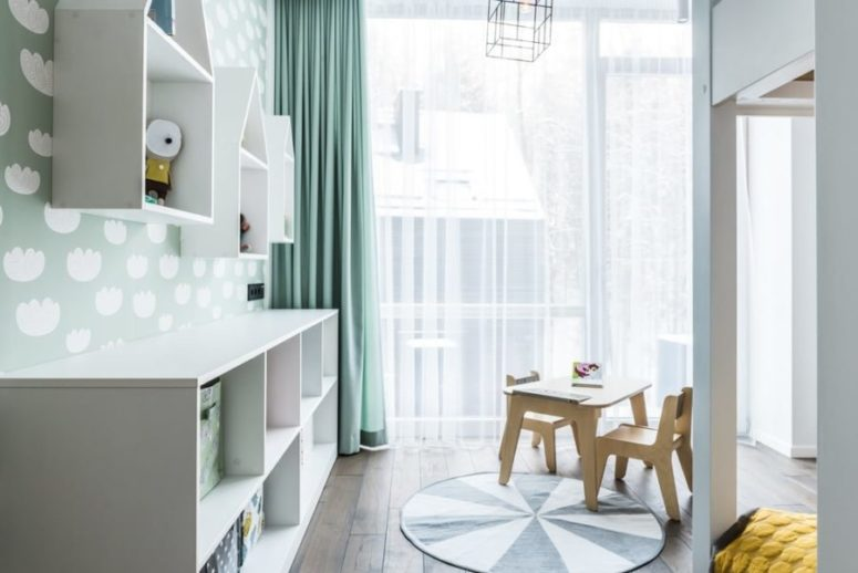 The kids room is filled with light, it's done in the same shades but with greens to make it more kids-like
