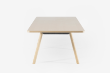 06 The tabletop is finished in ash wood veneer, giving it a smooth texture