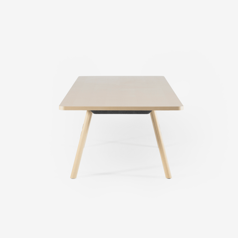 The tabletop is finished in ash wood veneer, giving it a smooth texture
