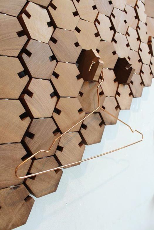 unique wooden honeycomb tiles that are functional and can be used for hanging and holding