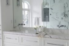 06 white marble bathroom with a mirror wall looks lightweight and airy