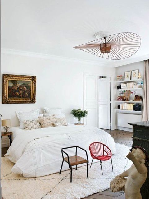The bedroom has a relaxed feel and cool artworks make it more refined and chic