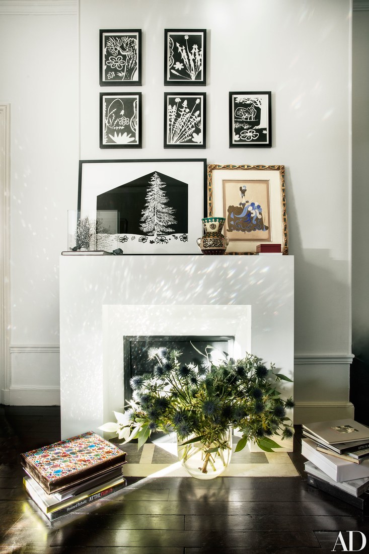 The fireplace as used for displaying the artworks mostly and I love thistles instead of flowers