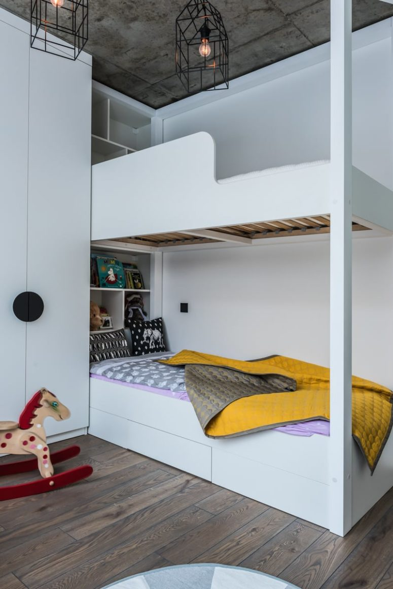 There's a bunk bed and all the storage is again sleek and hidden, which helsp to declutter the space