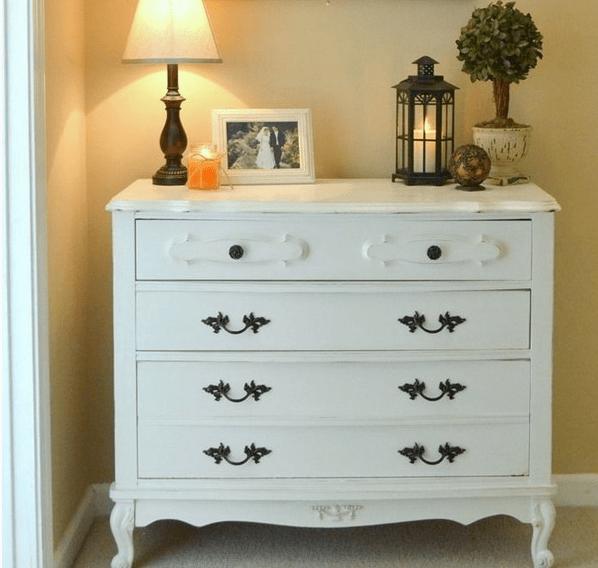 chic white dresser in vintage style, dark handles