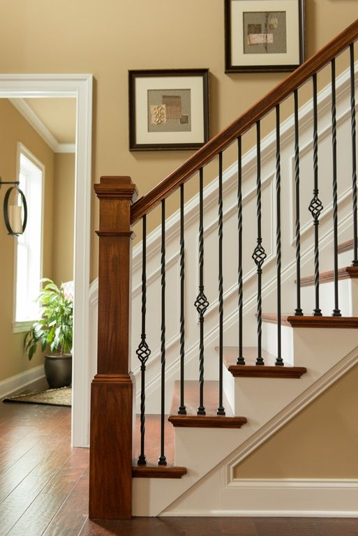 Classic Warm Wood Stairs With Stylish Iron Railing Can Make A Statement