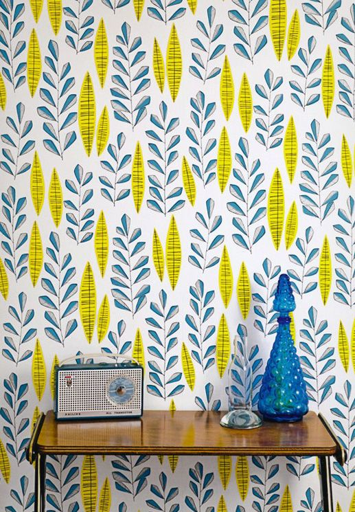 crazy blue and yellow botanical print wallpaper for an entryway