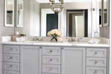 07 traditional grey cabinetry with a marble counter and a giant mirror up to the ceiling