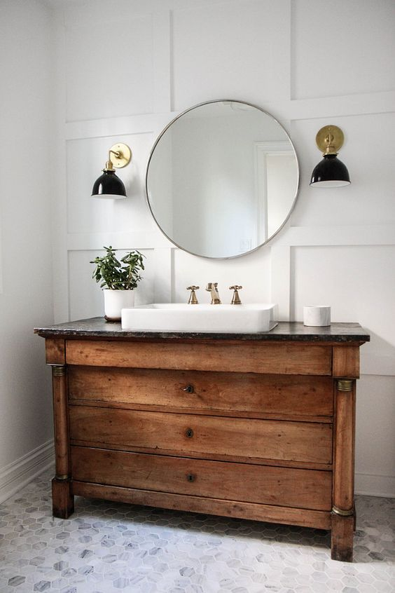 vintage wooden vanity with drawers and a stone countertop - 34 Rustic Bathroom Vanities And Cabinets For A Cozy Touch - DigsDigs