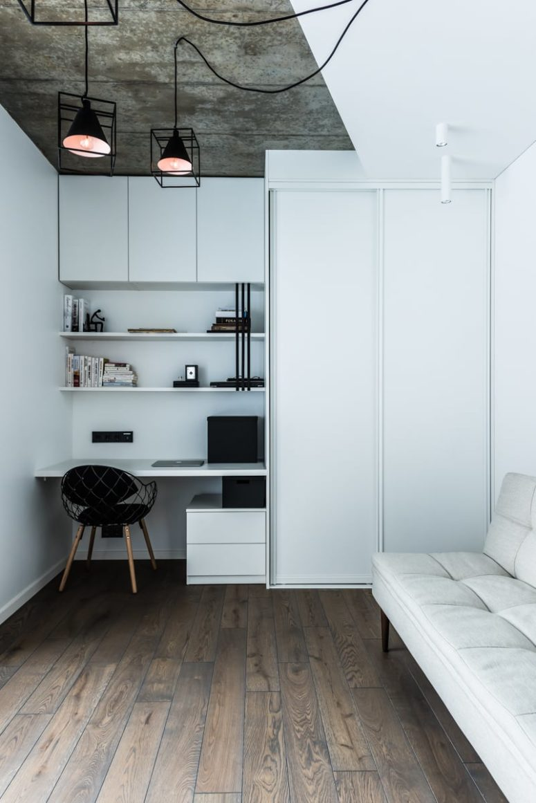 Small and neutral home office with everything necessary, a desk, a sofa and a storage unit