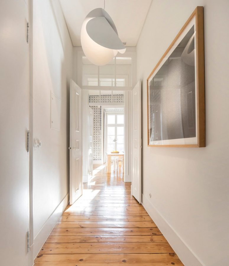 The apartment got a modern renovation with chic light fixtures and works of art