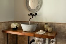 08 a galvanized bathroom sink on a wooden countertop with black pipe legs