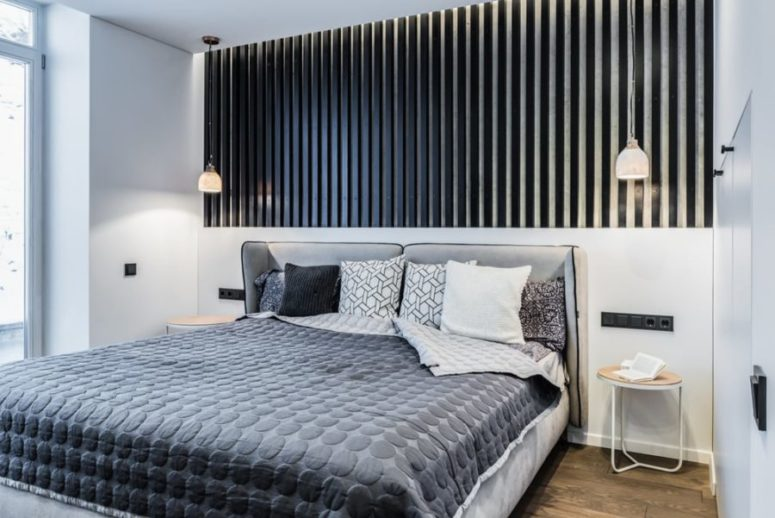 Black wood feature wall defines the whole bedroom look, it's just fantastic and perfectly matches all the rest