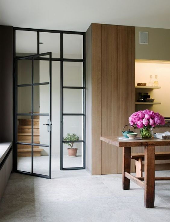 French Door With Black Metal Framing To Separate The Hallway From The  Kitchen
