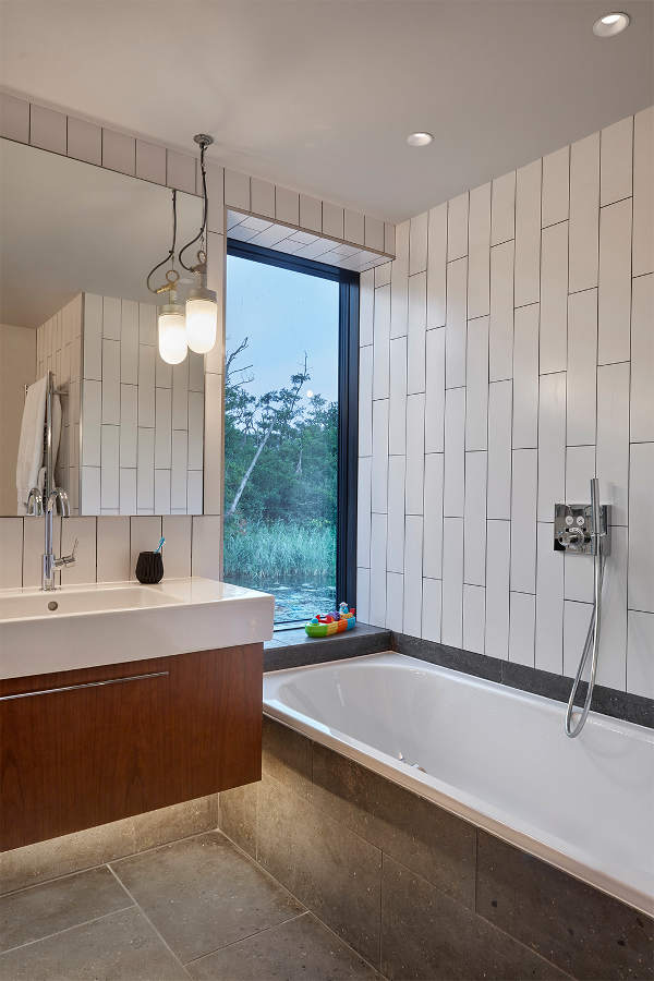 The master bathroom has views also, a floating vanity and concrete panels for durability