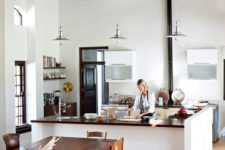09 a modern farmhouse kitchen with a hearth and a rustic dining space with different chairs