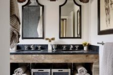 09 a stone and reclaimed wood vanity with open shelving inside