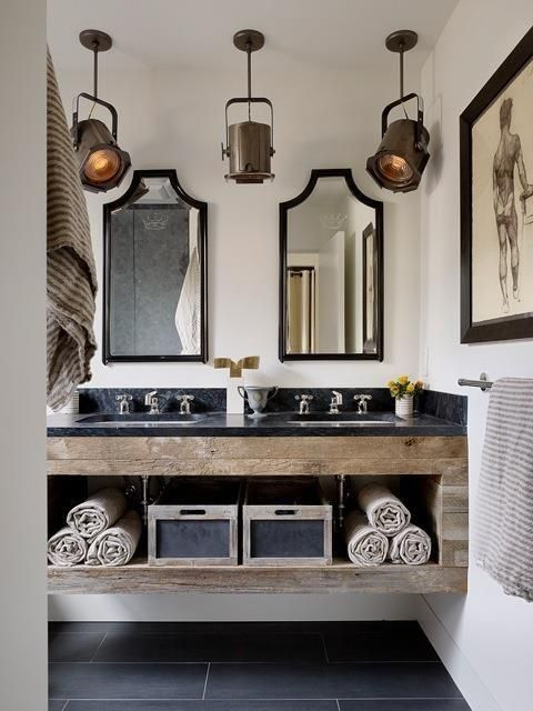 a stone and reclaimed wood vanity with open shelving inside