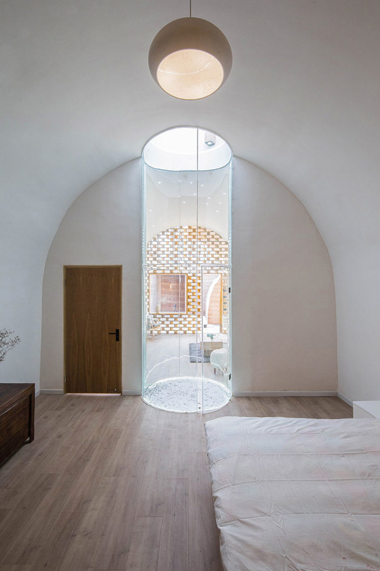 The central skylight creates a light tunnel separating the bedroom and living space