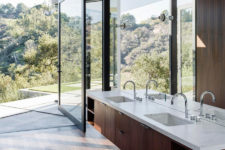 10 bathroom opened to outdoors, warm dark woods and a mirror wall to capture even more views