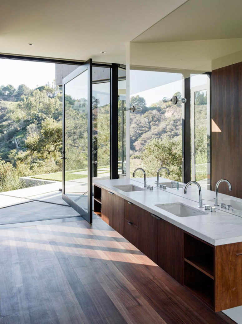 bathroom opened to outdoors, warm dark woods and a mirror wall to capture even more views