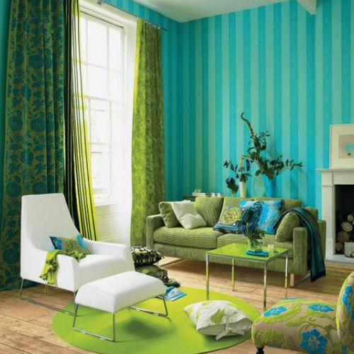 lime green, turquoise and blue living room with a crispy white chair