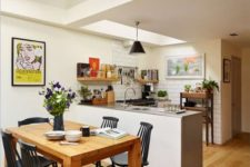 10 mid-century modern kitchen with subway tiles and a dining space with black chairs