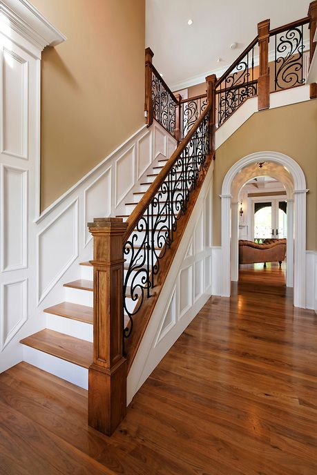 traditional oak staircase with worugh iron railing