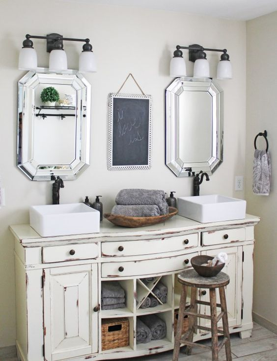 vintage cream-colored bathroom vanity with a worn look