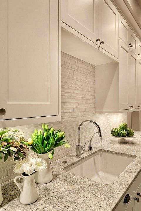 white cabinets look great with such stone-inspired grey countertops
