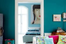 11 a teal statement wall and lime green accessories are a great combo for a vivacious living room