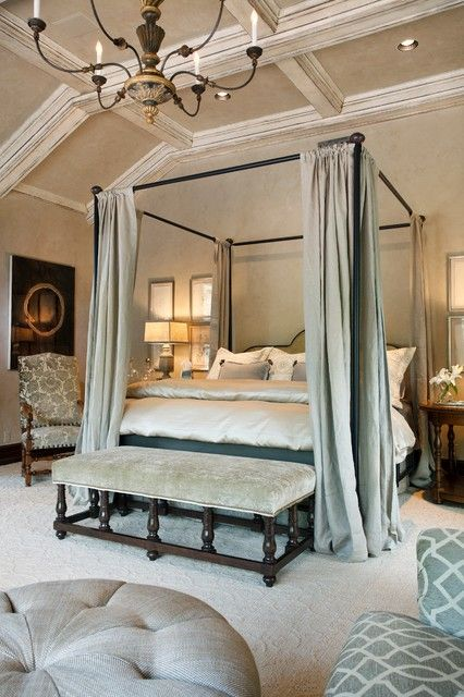 luxurious bedroom with a dark bed and neutral green fabrics