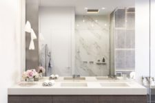 11 modern bathroom with dark woods, white marble and a mirror wall
