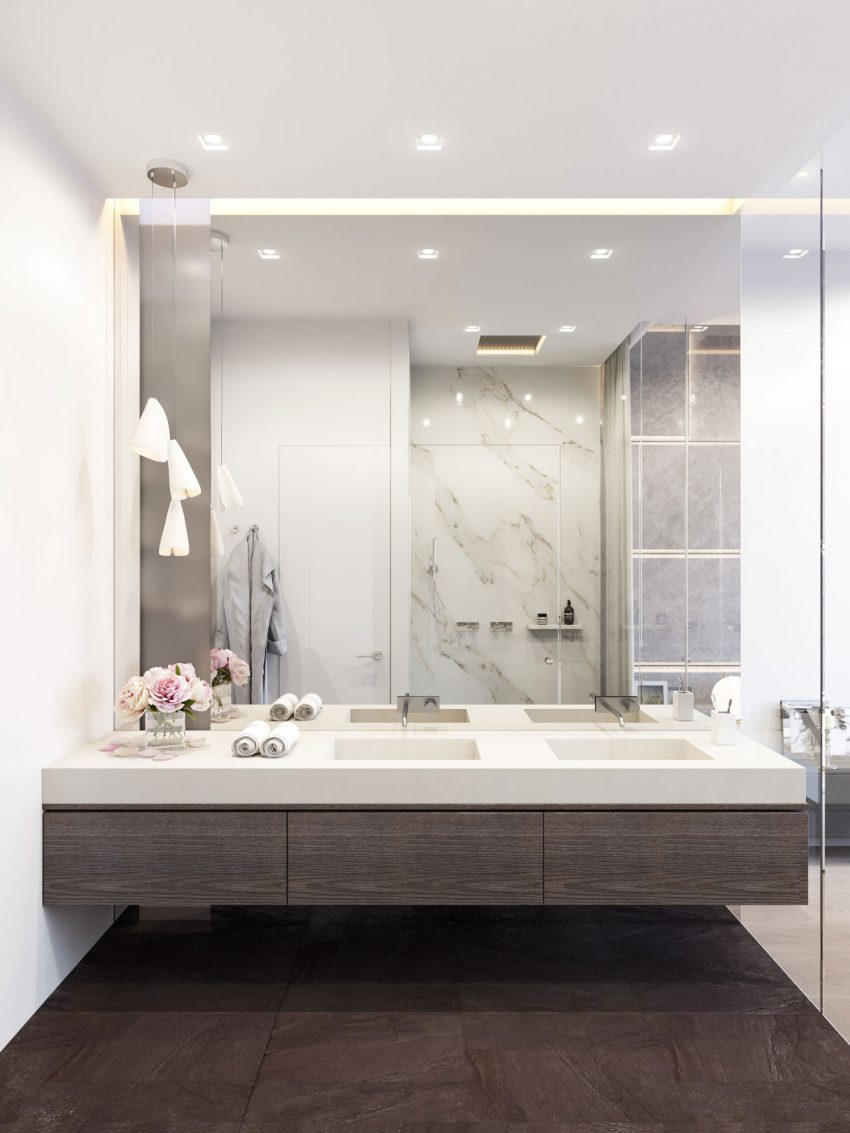 modern bathroom with dark woods, white marble and a mirror wall