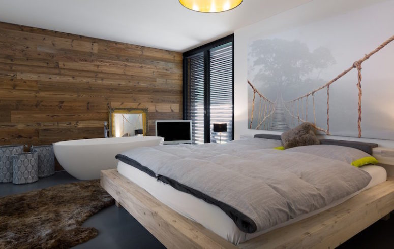 The bedroom has a boho feel with a free-standing bathtub by the bed