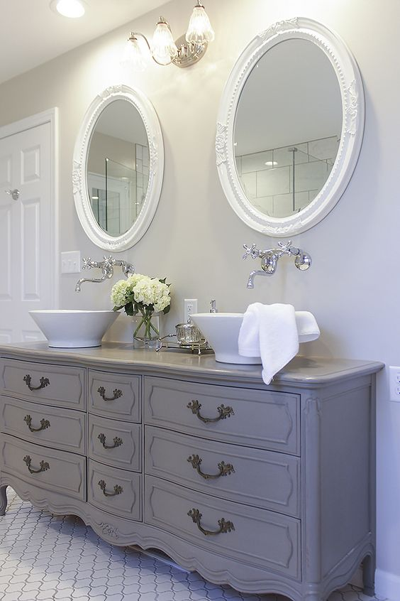 a grey vintage French dresser into a double sink vanity