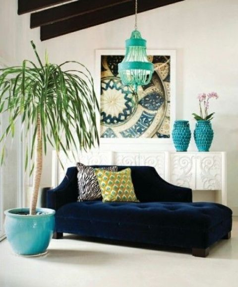 a navy sofa and turquoise accessories create an ambience in a neutral room