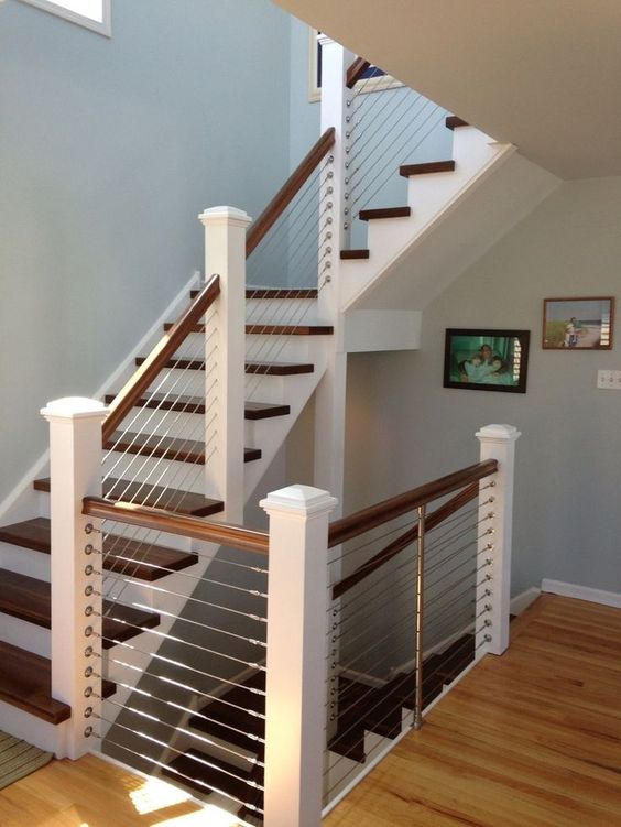Classic White And Dark Wood Staircase Is Made More Modern With Cable  Railings