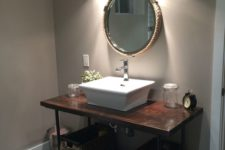12 dark stained wooden and metal pipe vanity with baskets instead of drawers